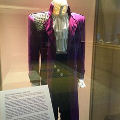 Prince's purple jacket and white shirt from the movie, Purple Rain, are on display at Paisley Park