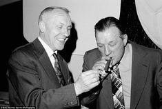 Bill Shankly lights a cigar for his successor Bob Paisley, who was named as the Football Manager of the Year at a lunch in Glasgow, 14th May 1976.