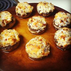 Sara's stuffed mushrooms 8 mushrooms 2 tbls butter 2 cloves of garlic pressed 4 slices bacon crumbled 1/3 cup Kraft Parmesan cheese  1/3 cup whipped cream cheese  Clean mushrooms, pull stems and chop the stems. Heat oven to 375. Heat butter and sautéed chopped stems, pressed garlic,  and bacon. In a small bowl mix cream cheese, parmesan cheese, and sautéed ingredients well. Stuff mushrooms and bake 20-25 minutes, or till golden brown!