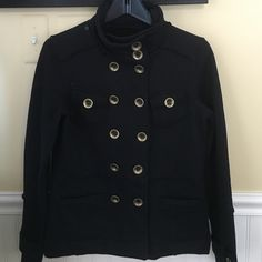 BLACK KNIT FUNNEL NECK JACKET This is a black knit medium weight jacket with a button up funnel neck that can be turned down. Double row of gold buttons and chest and hip pockets. Sleeve cuffs have small straps and buttons. Poly/cotton knit blend. Worn once, excellent condition. Sugarfly Jackets & Coats