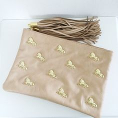 bf22015670 ASOS nude real leather clutch with gold horse detail & tassel zips • two  compartments,