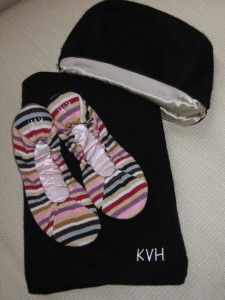 Kelly Van Halen Cashmere Travel Blanket Set in Brown - Those striped slippers are a dream.