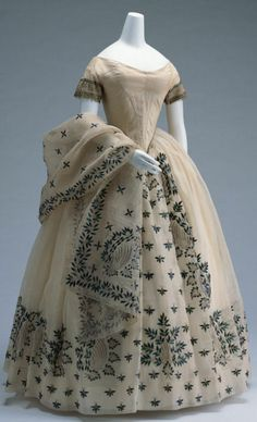 Evening Dress c. 1850-India?, White mullin; mullin on silk satin for bodice; floral motif embroidered with jewel beetle elytra and gold thread; matching shawl. (from Kyoto Costume Institute)