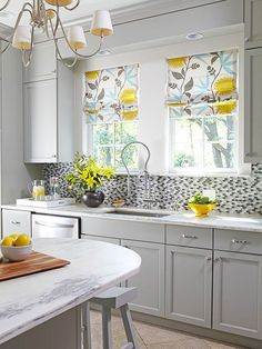 Color your cares away when you dress cabinets top to bottom in soul-soothing gray. These cabinets create an air of calm in the kitchen while the oval mosaic backsplash provides playful texture. Touches of yellow shoo away the serious side of gray, splashing the space with sunshine.