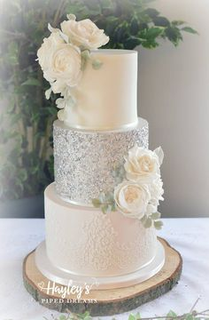 White and silver grey wedding cake with lacy details and beautiful sugar roses. - White and silver grey wedding cake with lacy details and beautiful sugar roses. Looks amazing in si - Diy Wedding Cake, Wedding Cake Roses, Floral Wedding Cakes, White Wedding Cakes, Elegant Wedding Cakes, Beautiful Wedding Cakes, Wedding Cake Designs, Wedding Themes, Wedding White