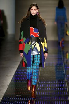 Au Jour Le Jour. Leggings as layering pieces were HUGE in Milan. See all the fashion week runways with the trend.