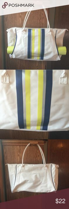 DSW Tote Bag w/Yoga Mat DSW tote/gym bag with yoga mat. It is cream colored with yellow and blue stripes. It is 23.5 inches long and 12 inches tall. I am willing to sell it with or without the yoga mat, just let me know what you'd like! The tote has not been used and the yoga mat is still in its packaging. DSW Bags Totes
