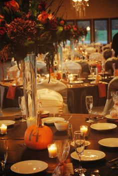 Pumpkin table numbers and rich, fall tones are the perfect way to achieve a fall themed wedding