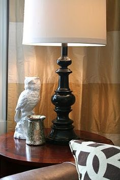 ceramic owl was $2 at a thrift store, and painted it white...not to mention ugly lamps so improved with solid paint color