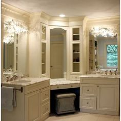 Separate sinks with vanity in the middle, so cute.