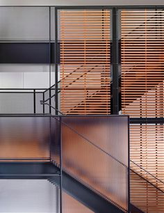 Metal stairs incorporating wood slats and ribbed glass panel