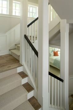 Ok I really like this too, contrast with light oak flooring (like yours) white spindles and a dark stained railing. I think this would be nice to pick up the darker accents you have with your light fixtures in the entry