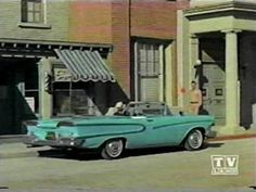 Mount Pilot's big success, Barney Fife (Don Knotts) arrives back in Mayberry, NC behind the wheel of a used 1958 Edsel Pacer convertible. That's sheriff Andy Taylor (Andy Griffith) on the curb by the courthouse.