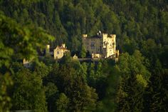 Image : Hohenschwangau Castle or Schloss Hohenschwangau (lit: High Swan County Palace) is a 19th-century palace in southern Germany. It was the childhood residence of King Ludwig II of Bavaria and was built by his father, King Maximilian II of Bavaria. It is located in the German village of Hohenschwangau near the town of Füssen, part of the county of Ostallgäu in southwestern Bavaria, Germany, very close to the border with Austria.