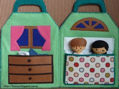 felt dolls in a felt home