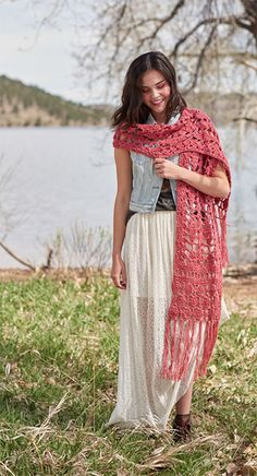 I absolutely love this crochet scarf. Bulky yarn in this design makes the stitch pattern pop. Open lace provides drape, and lanky fringe gives a flirty touch.