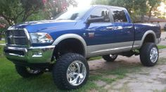 lifted Blue Dodge Ram truck with nice tires