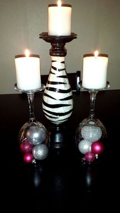 Upside down wine glasses+ ornaments+ candles= cute cheap center piece