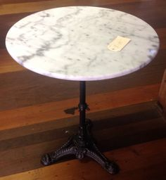 Cast iron base marble top table