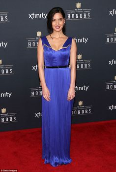 Stunning: While Aaron wore a classic suit, Olivia Munn was unmissable in a violet, floor-length gown