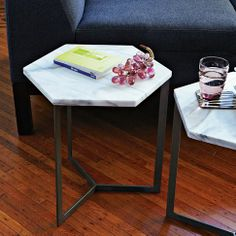 With its white marble top, raw steel base and hexagonal shape, the Hex Side Table can be used as more than just a sidekick to a sofa. Place a few side by side to use as a coffee table in a larger honeycomb arrangement. Modern Accent Tables, Decor, Side Table, Furniture, Modern Table, White Side Tables, Marble Coffee Table, Coffee Table, Marble Side Tables