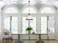 boxwood-clippings arch windows + high gloss ceilings
