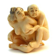 A Japanese carving - netsuke - of an old couple in an intimate embrace - probably carved in ivory.