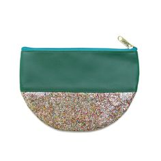 Our Glitter & Vinyl Clutch is available in four hip hues! #fairtrade #ecofashion
