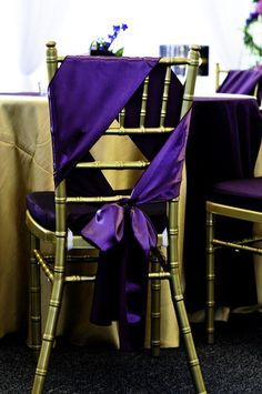 Purple sash on gold chair
