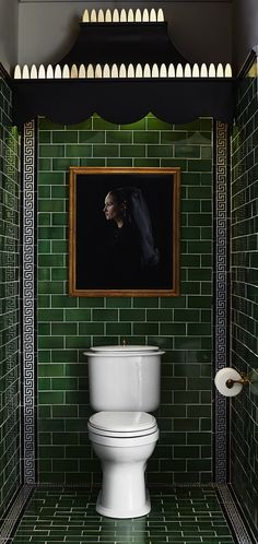 Rich green floor & wall tile by @heritagetile sets the stage for the Oak Hill Elongated toilet to shine as a decorative fixture in Susan Jamieson's Classic Charleston-inspired #DXVDesignPanel design.