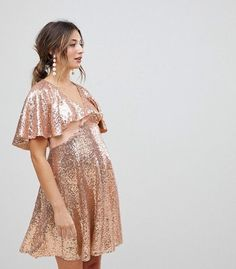 11 New Year's Eve 2017 Maternity Dresses That Will Make Your Bump Shine