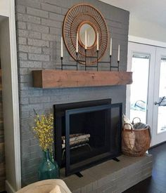 to Paint a Brick Fireplace (and the Best Paint to Use!) This color of grey and fireplace screen. How to Paint Brick, Painted Brick FireplacesThis color of grey and fireplace screen. How to Paint Brick, Painted Brick Fireplaces Grey Fireplace, Fireplace Update, Brick Fireplace Makeover, Home Fireplace, Fireplace Design, Fireplace Ideas, Brick Fireplace Remodel, Painting A Fireplace, Fireplace Furniture