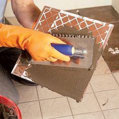 Tile Installation: How to Tile Over Existing Tile How to tile over tile. For kitchen/laundry room. Tile Over Tile, Bathroom Floor Tiles, Tiling, Wall Tiles, Modern Flooring, Kitchen Flooring, Flooring Ideas, Tile Flooring, Ceramic Tile Crafts