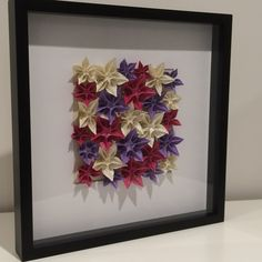 Origami Carambola Flowers in a black frame. Order via www.facebook.com/ChienoWa.Origami