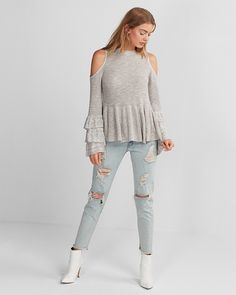 Look chic while staying cozy in this sweater that wows with trendy layered sleeves. Pair with denim or dress pants for a comfy, versatile look on cold days.