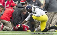"Sportsmanship:  Devon Gardner consoling Ohio State red shirt freshman J.T. Barrett who had just fractured his ankle during the UM-OSU game November 29, 2014. ""You hate to see any player get hurt but especially a player like him, who's a great guy, a high character guy, hard worker. . .It's like having a little brother out there and get hurt and I didn't like that at all. . .I just let him know I'm praying for him and told him to keep praying and everything would be alright."""