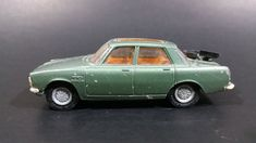 1968-1971 Corgi Toys No. 257 Rover 2000TC Metallic Green Die Cast Toy Car Vehicle Made in Great Britain https://treasurevalleyantiques.com/products/1968-1971-corgi-toys-no-257-rover-2000tc-metallic-green-die-cast-toy-car-vehicle-made-in-great-britain #Vintage #1960s #1970s #CorgiToys #Corgi #Toys #Rover #2000TC #DieCast #Cars #Vehicles #Autos #Automobiles #Collectibles #60s #70s #GreatBritain