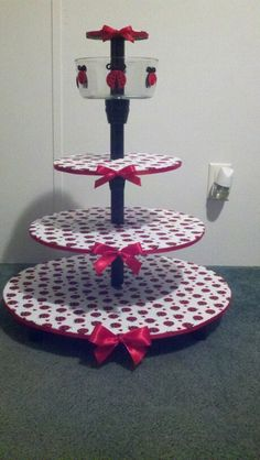 Cupcake stand made by my husband for a baby shower. I later decorated it with lady bug cupcakes all around and gum balls in glass bowl and a giant fondant lady bug on the top tier! This whole display was the center of the candy buffet table. Nailed it!