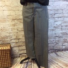 "DOCKERS PINSTRIPED TROUSERS Gently used gray trousers with a light pinstripe. 28.5""inseam 15"" waist lying flat Dockers Pants Trousers"