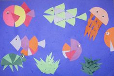 Fraction Fish  Third grade students learn about fractions in their Math class. They used their knowledge of fractions to create an underwater picture using cut paper circles. they were asked to identify different fractions in their pictures, such as 1 whole, 1/2, 1/4, 1/8, 1/16, some students even created pieces as small as 1/32
