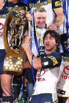 Johnathan Thurston's on-field bodyguard Gavin Cooper accidentally opened the gash on his head just seconds after North Queensland won the NRL Grand Final. Johnathan Thurston, National Rugby League, Cowboys Win, Best Football Players, The End Game, Beefy Men, Farm Hero Saga, Best Player, His Eyes