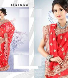 saree is in 60g georgette with all over crowded beautiful zarri buttis to give it  heavy look.  It is the best option to be worn in a wedding of a friend or a relative.