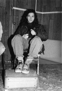 LOS ANGELES - January 24 - Pearl Jam Rock for Choice Hollywood Palladium - Black and white view of Eddie Vedder relaxing backstage after performing with Pearl Jam in Rock for Choice benefit concert at the Hollywood Palladium 01/24/92.