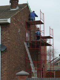 The ten-year-old boy was spotted on scaffolding in Merseyside