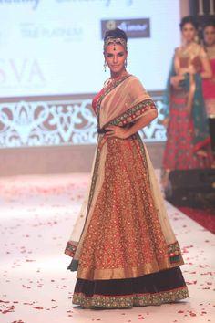 Neha Dhupia walks the ramp of the Indian International Jewellery Week