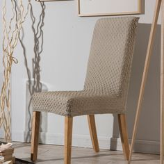 Housse de chaise bi-extensible unie effet gauffré beige MARINE Comptoir des toiles vente privée
