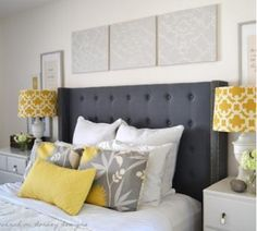 navy, yellow and grey bedroom with button tufted headboard