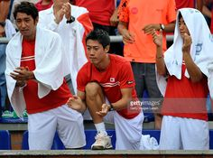 Yasutaka Uchiyama, Kei Nishikori and Yoshihito Nishioka of Japan celebrete a point during the Davis Cup World Group Play-off singles match between Alejandro Falla of Colombia and Taro Daniel of Japan at Club Campestre on September 20, 2015 in Pereira, Colombia.