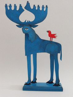 This whimsical Moose Hanukkah Menorah by ACME Animal is hand-painted. A work from the ACME Animal collection will be a welcome addition to any home for Hanukkah