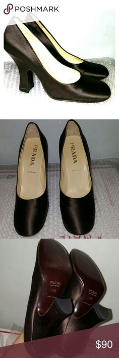 """Prada satin pumps brown chocolate 38.5 4"""" heel. Dark brown satin upper. Beige leather lining. Round toe. Right shoe has a scratch on a satin upper (outer bottom heel area, see third pic). Left shoe has a small whitish spot (heel area). Worn twice at most. Made in Italy. Nice classic pair. Size 38.5...and according to Prada's shoe conversion chart=8 US. Prada Shoes Heels"""